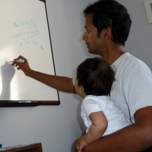 Daddy teaching Safa math.